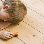 111108082205-boy-child-playing-car-floor-autism-horizontal-large-gallery